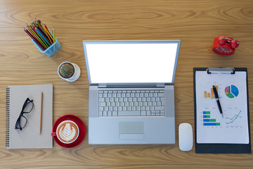 Office desk table with laptop,smartphone and coffee cup and accessories. Top view of workplace