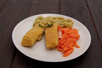 Red lentil with broccoli and millet croquettes on a table