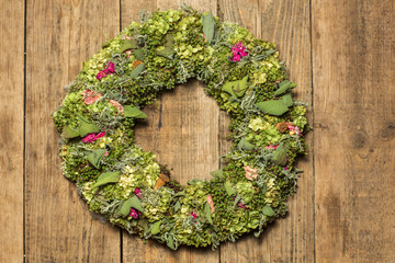 beautiful flower wreath isolated on awooden background