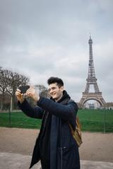 Tourist taking shots of Eiffel tower