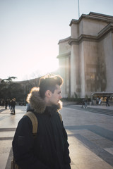 Young tourist standing on square
