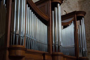 Horizontal View of Close Up of the Pipes of a Pipe Organ in a Church. Bari, South of Italy