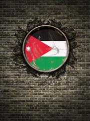 Old Jordan flag in brick wall