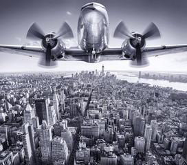 Wall Mural - historic aircraft in the sky over manhattan