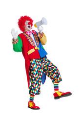 Happy walking clown announcing into loudspeaker