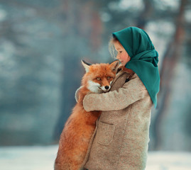 little girl with Fox in the woods