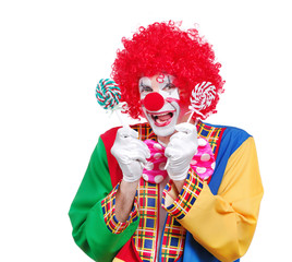 Happy clown holding lollipop sweets isolated on white background
