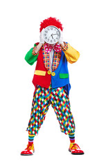Full length  picture of a clown hiding face behind wall clock