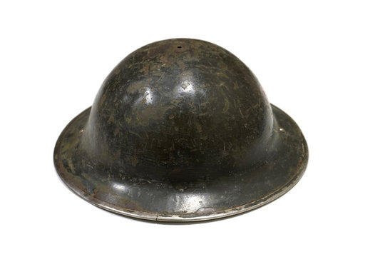 Genuine World War One helmet isolated on a white background side view