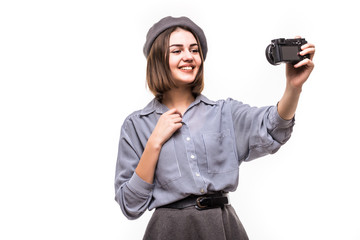 Portrait of a happy woman blogger wearing beret speak to camera while record video isolated over white background