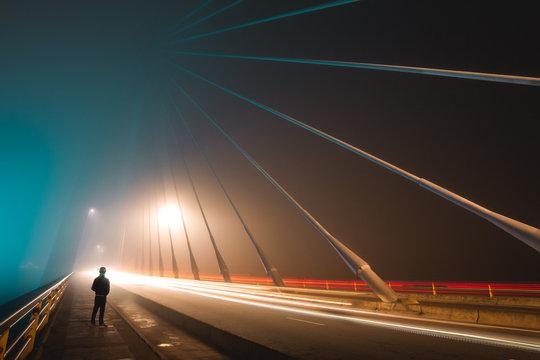 Long exposure in foggy night on iron bridge