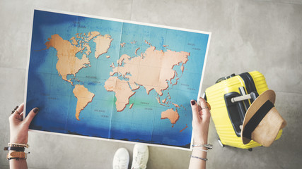 Woman holding world map travel concept