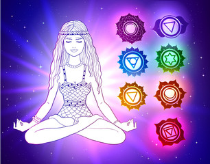 woman sitting in pose of lotus with glowing chakras