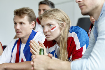 British football fans watching match together at home