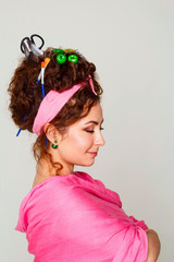 Portrait of young and funny woman with interesting and creative hairstyle