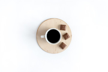 Mug of coffee and chocolate on a white background