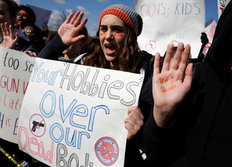 Students from Washington, DC-area schools protest for stricter gun control during a walkout by students at the U.S. Capitol in Washington