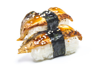 Sushi pieces placed between chopsticks, separated on white background. Popular sushi food.