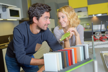 Man and lady chosing color scheme for kitchen