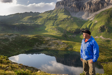 Man relaxing and enjoying beautiful summer mountain landscape