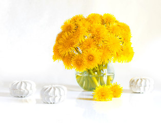 Bouquet of spring flowers. Still life of dandelions and marshmallows. Isolated on white background.