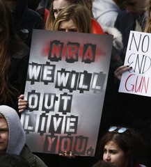 Students gather and rally outside the U.S. Capitol during walk-outs in support of stricter gun laws in Washington