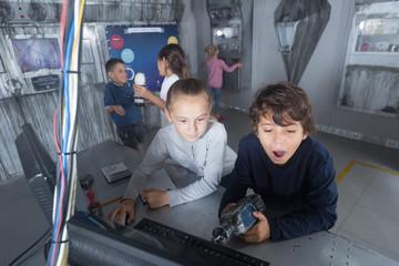 company of children in quest room bunker