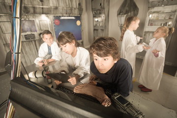 Children looking for a clue in the bunker quest room
