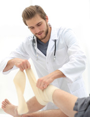 doctor removing the bandages from the patient's foot