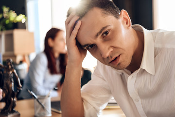 Adult puzzled man makes decision about signing marriage dissolution agreement.
