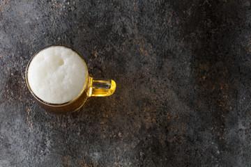 mug with beer on a vintage background