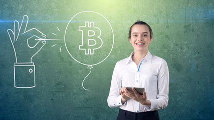 Woman standing near btc logo. Concept of virtual criptocurrency bitcoin dawnfall and correction.