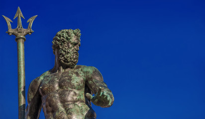 Neptune God of the Sea bronze statue with trident, from the Fountain of Neptune, erected in 1566 in the historic center of Bologna (with copy space)