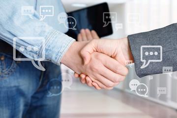 Employees shake hands .