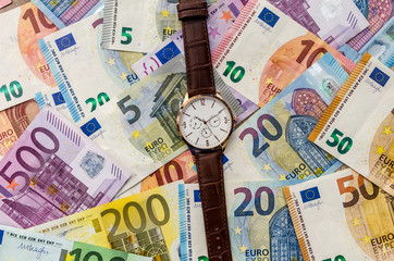 Clock on euro banknotes. close up .