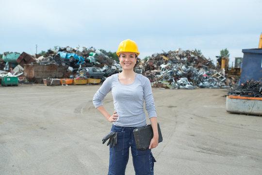 female junkyard worker