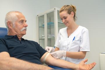 nurse preparing patient for a blood test