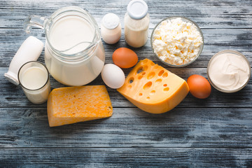 Dairy products grocery assortment on rustic wooden table. Top view.