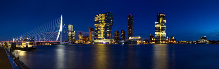Fototapeten Rotterdam City Landscape, panorama - Night view on Erasmus Bridge and district Feijenoord city of Rotterdam, The Netherlands.