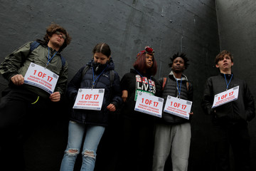 Students holding signs in honor of the victims of the Marjory Stoneman Douglas High School wait before taking the stage during a rally held at the Prospect Park Bandshell for the National School Walkout in Brooklyn, New York