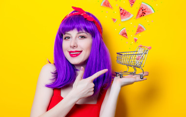 girl with purple color hair and supermarket cart