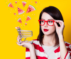 woman in glasses with shopping cart