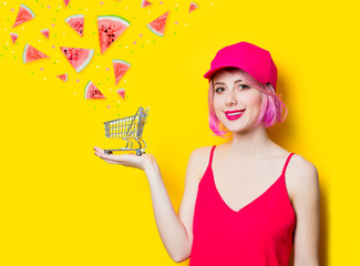 woman with shopping cart and watermelon