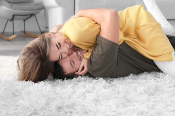 Cute young lovely couple having fun at home