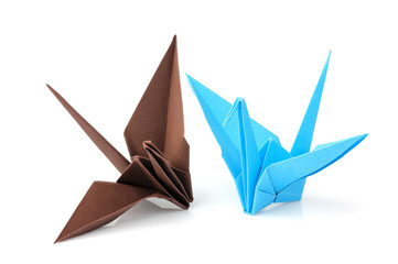 Two origami cranes isolated