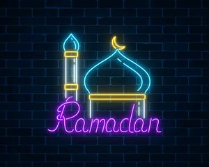 Ramadan kareem greeting text with mosque dome and minaret.