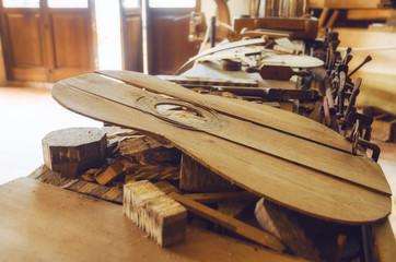 Old luthier's bench in a workshop of a guitar maker craftsman