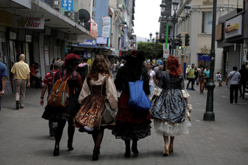 "Adriana Barahona,Maria Jose Rovira, Carolina Aguero and Amy Murcia  dressed in the ""Lolita"" style, walk in the central avenue in San Jose, Costa Rica"