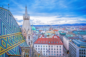 Lovely view from above of Vienna - the capital of Austria, European country. Iconic landmark and extremely popular European travel destination. View over roofs on classic architecture, day scenery.