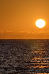 Beautiful tropical sunrise on the sea horizon. Vacation paradise background image.